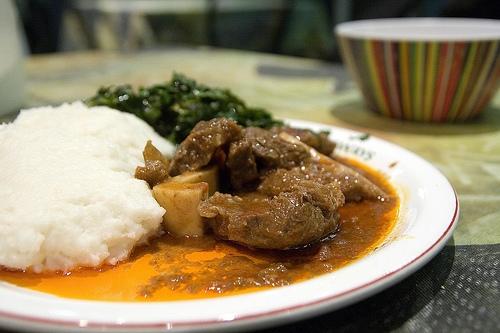Zimbabwean food sadza nenyama green vegetables
